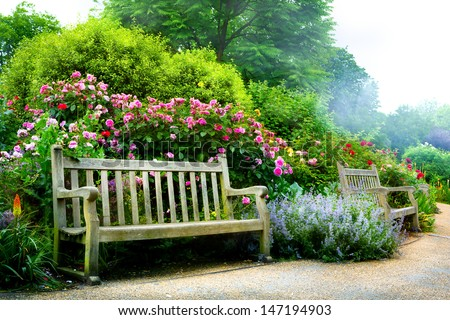 art bench and flowers in the...