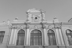art black and white scenic facade of an ancient historic house in St. Petersburg Russia, historical exterior of the famous antique architecture building tourist landmark in the city tourism