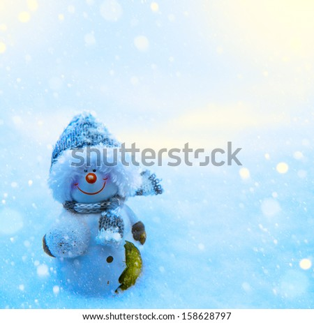 Art Christmas snowman and blue snow background