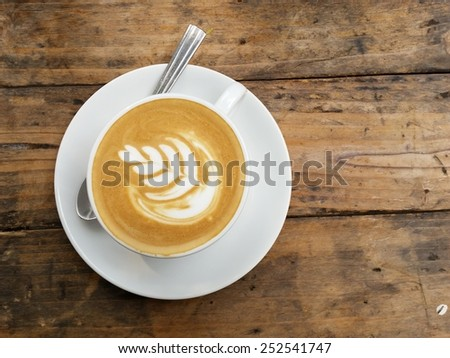 Art coffee .Cappuccino Coffee on Wooden table background