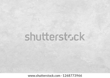 Art concrete or stone texture for background in black, grey and white colors. Cement and sand wall of tone vintage. #1268773966