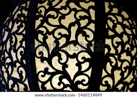 Art creation related to lantern oriental featuring oriental lantern shadows. The artistic domain is light, architecture.