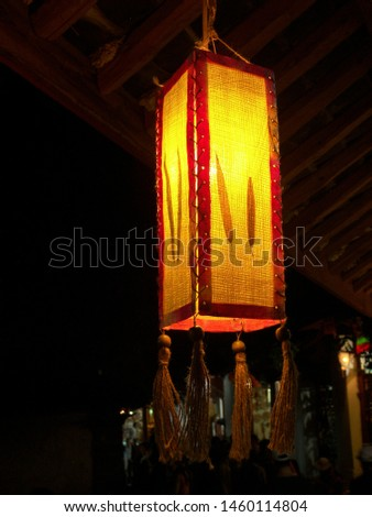Art creation related to lantern oriental featuring oriental pendant fabric. The artistic domain is light, architecture.
