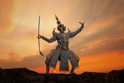 Art culture Thailand Dancing in masked khon Tossakan in literature ramayana on the brick wall at sunset time ,Thailand