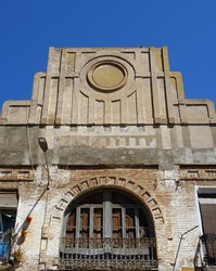 Art deco building with balconies and beautiful decorated pediment. Cabanyal Quarter in the city of Valencia. Spain.