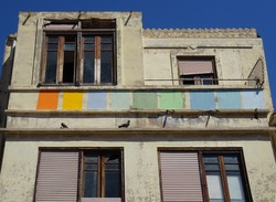 Art deco dilapidated building with colorful facade. Cabanyal Quarter in the city of Valencia. Spain.