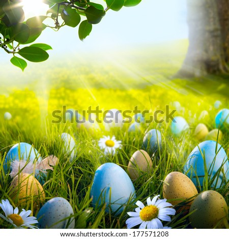 Art decorated easter eggs in the grass with daisies