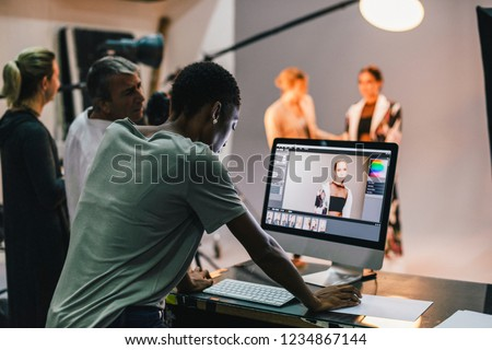 Art director checking the photos on a monitor #1234867144