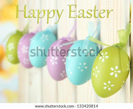 Art Easter background with eggs hanging on fence #133420814