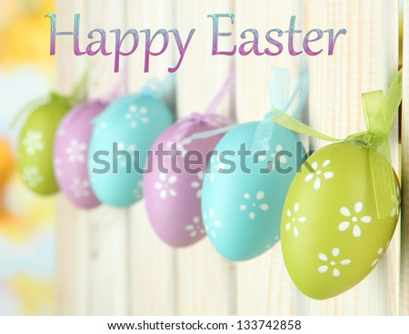 Art Easter background with eggs hanging on fence #133742858