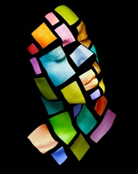 Art fashion glowing make-up. Portrait of a young woman posing in studio. Metallic colorful squares on woman face. Isolated on black background.