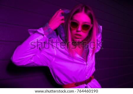 Art Fashion photo of a sexy model wearing glasses