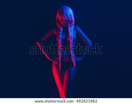Art Fashion photo of elegant model in the light colored spotlights with white Norway style braids