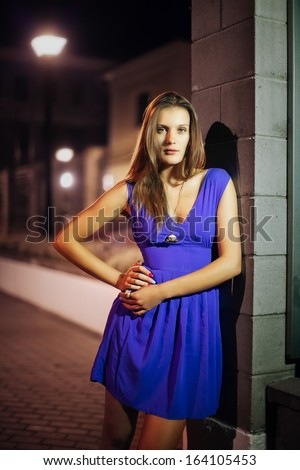 Art fashion portrait of young woman in night street. Shallow depth of field