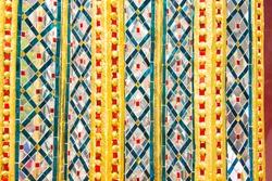 Art glass on wall of Wat Phra Kaew temple, Thailand.