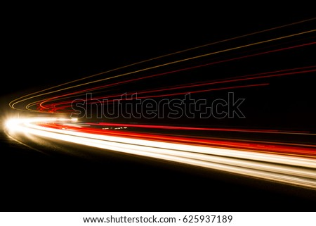 Art image . Long exposure photo taken in a tunnel below Veliko Tarnovo. Lights. Car headlights. Car light trails on the road