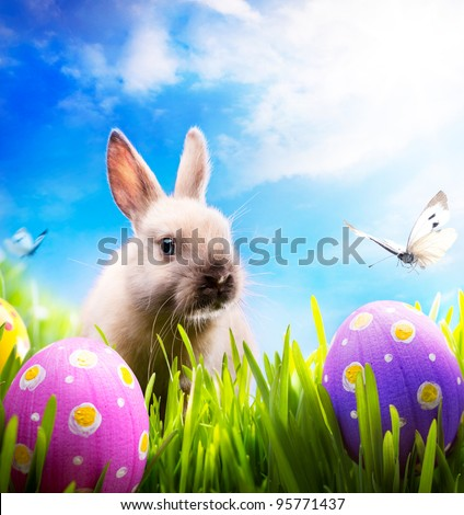 art Little Easter bunny and Easter eggs on green grass #95771437
