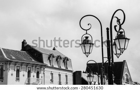 Art Nouveau style buildings and streetlights in resort town Mers-les-Bains (Picardy, France). Aged photo. Black and white. #280451630