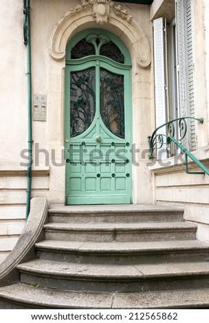Art nouveau style wooden door in Nancy, France