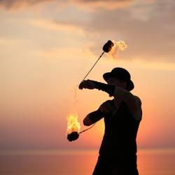 Art of fire dance; spinning fire poi