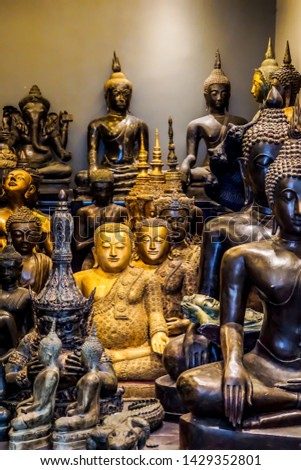 Art of various Buddha statues. Statues that are popular decorated in many places such as in sacred places, Well-appointed hotel, Spa Service, Restaurants, and in front of a large office building. Asia #1429352801