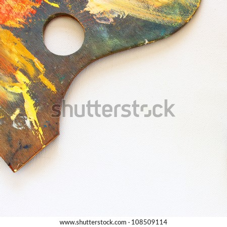 art palette with blobs of paint over  canvas texture - stock photo