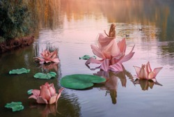 art photo fantasy. Autumn magic miracle. small blonde happy woman princess stands dancing in pink big huge lotus lily flower, on water of river. Short dress. image child of nature. Cartoon character
