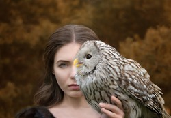 Art photo of a girl with half the face of a man and half the face of an owl