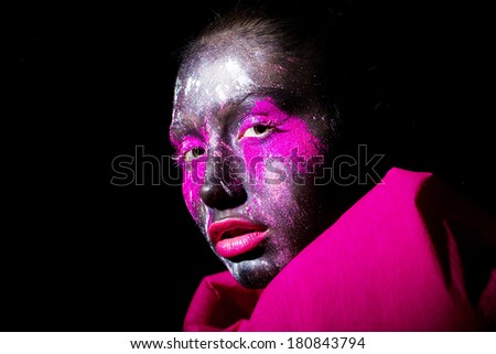art photo of beautiful model with creative unusual black mask colorful makeup. black face