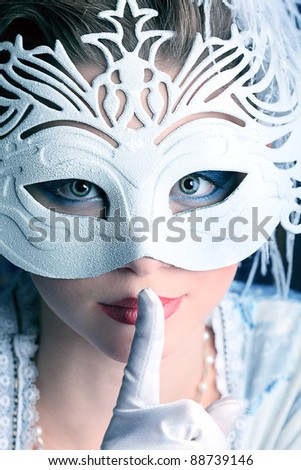 Art portrait of a beautiful female model in a snowy mask. Christmas.