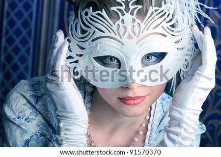 Art portrait of a beautiful female model in a snowy mask. Christmas.