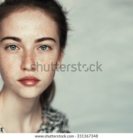 Art portrait of a beautiful young girl with freckles and a perfect face closeup - Shutterstock ID 331367348