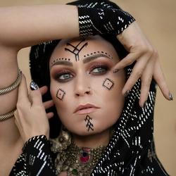 Art portrait of a Berber woman in a black turban