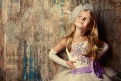 Art portrait of a pretty little girl wearing princess dress. Fashion shot. Childhood.