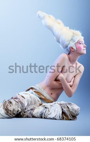 Art portrait of a professional model. Shot in a studio.