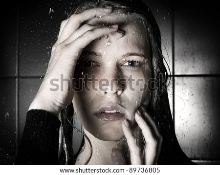 Art portrait of the young woman in the shower