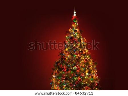 art shining lights Christmas tree red background