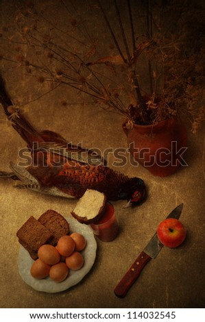 Art still life with a pheasant and bread