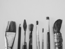 Art Tools, Brush Painting, trowel and Pencil on Canvas Backgroud in Black and White Art Style