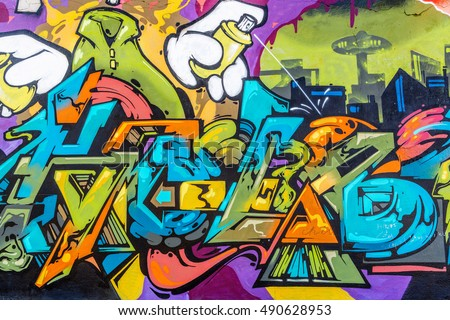 Stock Photo Art under ground. Beautiful street art graffiti style. The wall is decorated with abstract drawings house paint. Modern iconic urban culture of street youth. Abstract stylish picture on wall