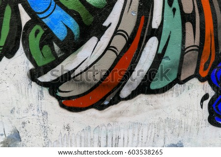 Art under ground. Beautiful street art graffiti style. The wall is decorated with abstract drawings house paint. Modern iconic urban culture of street youth. Abstract stylish picture on wall #603538265