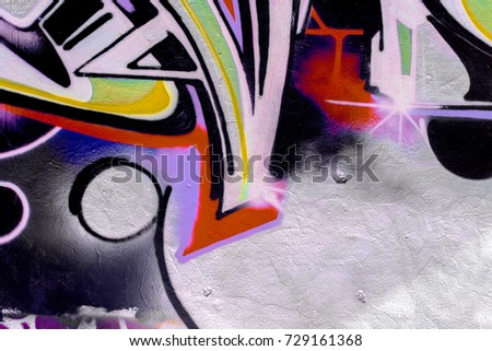 Art under ground. Beautiful street art graffiti style. The wall is decorated with abstract drawings house paint. Modern iconic urban culture of street youth. Abstract stylish picture on wall #729161368