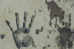 Art with hands in paint on wall concrete vintage
