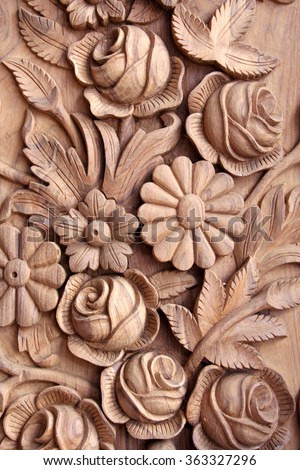 Art work carved in wood.Usually it is used in main doors of House in India