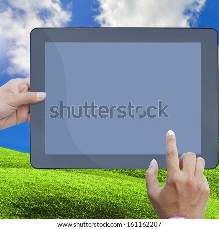 art work hand of business man hold the touch screen computer isolated on white background