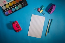 Art workplace with creative accessories, art tools for painting and drawing - Watercolors, pencils, hooks and stapler