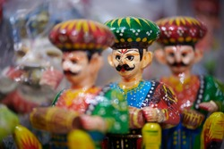 Artefacts or local traditional dolls sold at a store in Udaipur