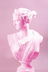 Artemis, a pink statue with a purple background