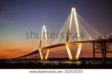 Arthur Ravenel Jr Bridge Illuminated in Evening over Cooper River Connecting Charleston and Mount Pleasant in South Carolina #322523273