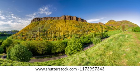 Arthur's Seat - hill in city Edinburgh, Scotland.  Summer mountain landscape panorama. Salisbury crags at  park